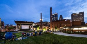 Members of the community attend an open air film presentation in the new Bailey Park in downtown Winston-Salem on Thursday, June 18, 2015. The skyline of Winston-Salem is in the background.