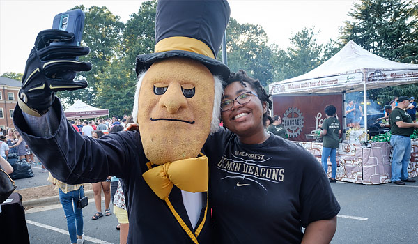 New Student Taking a Selfie with the Demon Deacon