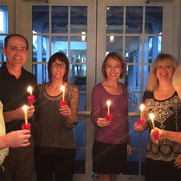 Group holding Lovefeast candles at home