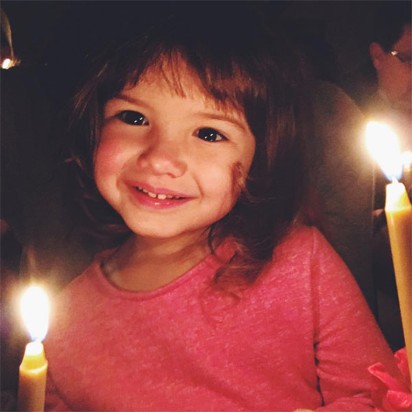 Child holding Lovefeast candle