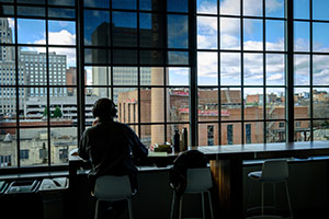 Student studying with view of downtown.