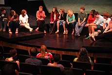 Cast members of The Laramie Project gather after a performance with the audience