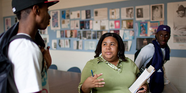 Wake Forest students talks with professor Erica Still.