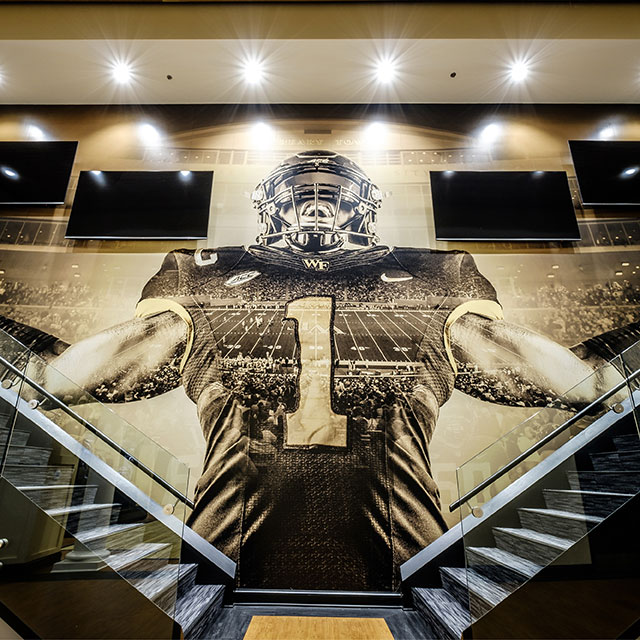 A football player graphic overlooks two staircases