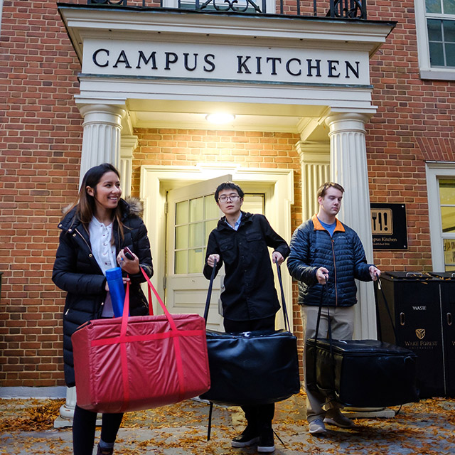 Students leave Campus Kitchen with Thanksgiving meals.