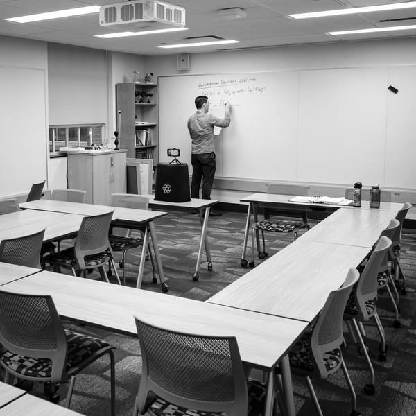 Professor David Wren films his lecture in an empty classroom.