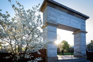 A student walks past the arch on Hearn Plaza on the campus of Wake Forest University on Wednesday, April 6, 2016.