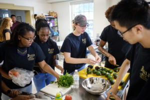New Wake Forest students in the BUILD pre-orientation program prepare a communal pot luck dinner in the Campus Kitchen space on Tuesday, August 22, 2017.