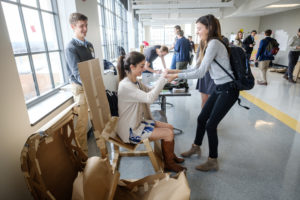 "Engineering Students work on their ""cardboard furniture"" project"