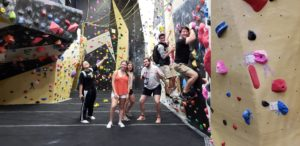 Students participating in the 2019 MazalWAKE pre-orientation program enjoy the rock wall inside the WF Wellbeing Center.