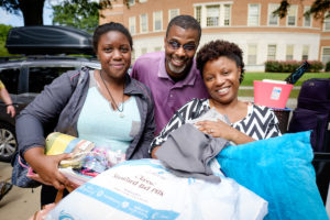 Wake Forest hosts move-in day for first year students at the south campus residence halls on Friday, August 21, 2015. Sierra Leslie ('19) and her parents, Tosheka and Stephen, pose outside Babcock.