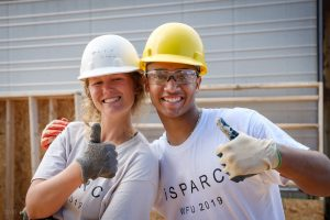 Wake Forest students in the SPARC pre-orientation program lay out and install pre-made wall sections at a Habitat for Humanity build site in East Winston-Salem on Tuesday, August 20, 2019.