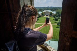 First year Wake Forest students in the Deacon Camp pre-orientation program visit the bell tower of Wait Chapel and see the carillon on Monday, August 21, 2017. Marlee Murrary ('21) shoots photos from a window in the bell tower.
