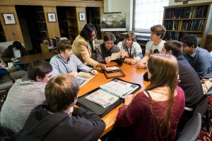 Wake Forest English professor Sharon Raynor and students in her writing class, When Writing Goes to War, look over letters and journals from soldiers in the Special Collections room of the Z. Smith Reynolds Library on Wednesday, October 30, 2013.  The students are looking through a journal and photographs that Raynor's father made during his service in Vietnam.