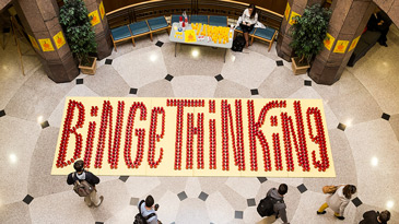 Binge Thinking spelled out by cups in Benson Center