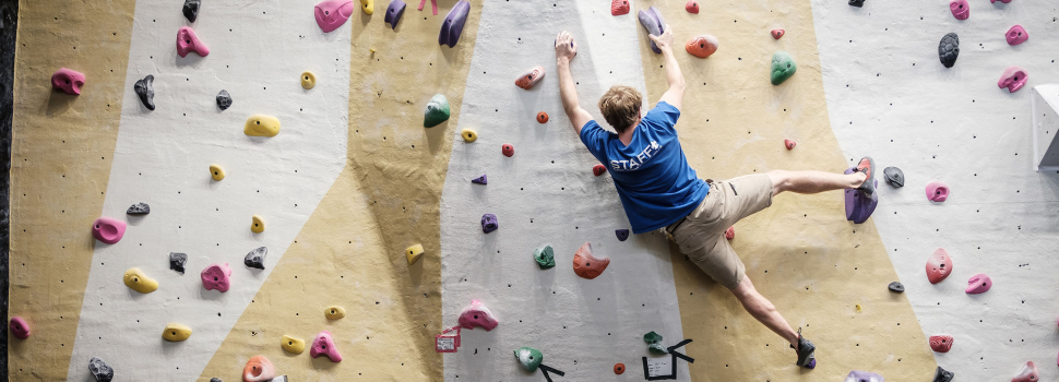 student on the climbing wall