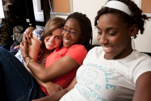 Wake Forest freshmen, from left, Nancy Davidson ('12), Brooke Thomas ('12), and Kadija Fornah ('12) hang out in Kadija's room in Bostwick Residence Hall on Friday, April 24, 2009.