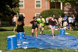 Wake Forest students set up a homemade sliding pool on the grass outside Bostwick Residence Hall on Thursday, April 23, 2009.
