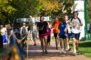 Members of the Wake Forest community run laps around Hearn Plaza to raise money for cancer research in the Hit the Bricks for Brian event, named after football player Brian Piccolo.