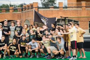 Carrying the Wake Forest flag at Pros vs. Joes