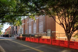 orange construction fencing as the Reynolds Gym renovation happens