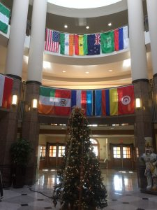 Benson Center decorated with holiday decor and international flags