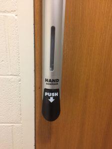 door handle/hand sanitizer dispenser