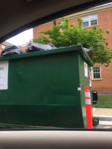 Dumpsters filled to the brim as students move out