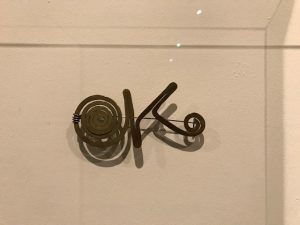 Pin of O'Keeffe's initials that was made by artist Alexander Calder