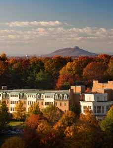 An aerial view of Polo Residence Hall on the campus of Wake Forest University, with Pilot Mountain in the distance.