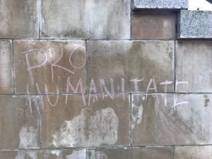 Pro Humanitate chalked on the wall