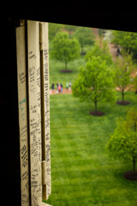 An aerial view of Hearn Plaza from the bell tower of Wait Chapel. You can see students' signed names in the windowsills.