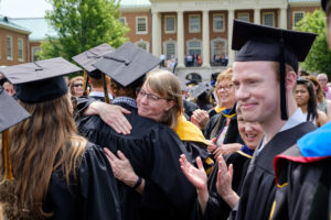 Wake Forest University holds its Commencement Ceremony on Hearn Plaza on Monday, May 21, 2018. Graduates walk through a gantlet of faculty members as they march in the recessional.