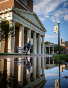 Wait Chapel is reflected in a puddle on Hearn Plaza on the campus of Wake Forest University.
