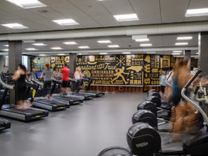 Graphic artwork covers the walls in the newly renovated Reynolds Gym as Wake Forest students exercise on Monday, August 27, 2018.