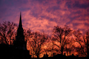 The sunrise illuminates the sky over Wait Chapel on the campus of Wake Forest University.