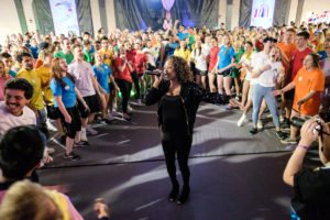 """Wake Forest students dance in the Sutton Center to raise money for cancer research in the annual Wake n Shake event on Saturday, March 23, 2019. Jesse Kyle, a soul singer from Philadelphia and a cancer survivor, performs as one of the """"champions"""" of the event."""