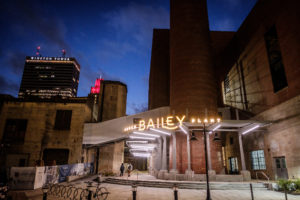 The Bailey Power Plant in downtown Winston-Salem has been renovated into restaurants, event space, and a brewery, shown at dusk on Wednesday, February 27, 2019.