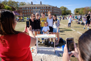 Wake Forest students paint desks for local elementary school students at the annual volunteer service project DESK, on Poteat Field on Wednesday, April 10, 2019.