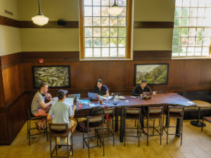 Students work at a large table in the Starbucks inside the Z. Smith Reynolds Library on Wednesday, April 24, 2019.