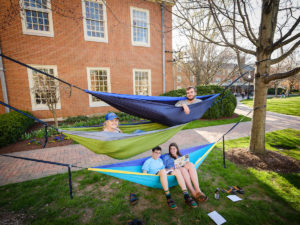 First year students Emma Ornduff, Sophia Masciarelli, Sam Apostolopoulos, and Jake Waldman hang out in their hammocks on Hearn Plaza as they enjoy a warm spring afternoon, on the campus of Wake Forest University, Thursday, March 28, 2019.
