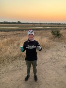 Jordan Diamond '23 in South Africa at Kruger National Park about to embark on an evening safari enjoying a local popular soft drink