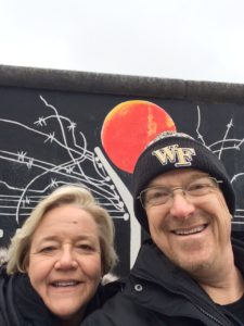 alumni parents Melanie and Rick Harkey at the Berlin Wall