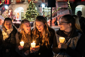 lighting of the quad candles - girls laughing