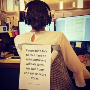 joke about person with sign on back saying don't distract me