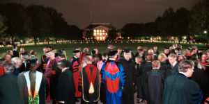 WFU faculty walk out onto the Quad lit with candles after the opening convocation of the new Divinity School. ©2002 Wake Forest University, Office of Creative Services. Photo by Ken Bennett.