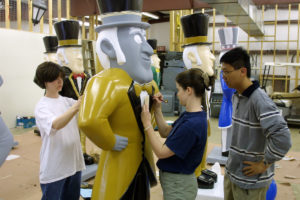 Wake Forest students Kelly Jones, left, Michelle Johnson, and Han Shi work on a model Demon Deacon in a campus warehouse on Thursday, April 5, 2001. The model, sponsored by the WFU Baptist Student Union, will be part of the Deacs on Parade event that kicks off the new capital campaign later this month.