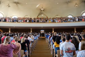 New Wake Forest students attend the Making of a Demon Deacon ceremony in Wait Chapel on Thursday, August 22, 2019. The new students thank their parents and family members.