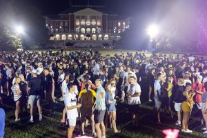 New Wake Forest students attend the Playfair meet and greet event late at night on the first day of orientation, on Manchester Plaza on Wednesday, August 21, 2019.