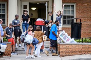 The Wake Forest Class of 2023 moves into their first-year residence halls on South Campus on Wednesday, August 21, 2019. Moving into Collins Residence with help from a cheering squad.